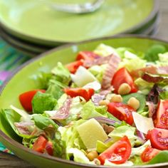 A hearty and satisfying chopped salad, with chickpeas, hard salami, olives, cheese, and an assertive oregano dressing.