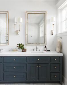 Light Mirror Combinations For Your Bathroom STUDIO MCGEE stunning white navy and gold bathroom w White Vanity Bathroom, Bathroom Vanity Cabinets, Gold Bathroom, Bathroom Faucets, Bathroom Interior, Small Bathroom, Bathroom Trends, Bathroom Ideas, Bathroom Mirrors