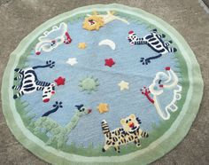 POTTERY BARN KIDS ANIMALS RUG 5ft ROUND 100% WOOL ELEPHANTS ZEBRAS GIRAFFE LION | eBay