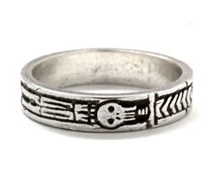 Originally carved here in NYC this comfortable skull ring is cast in .925 Sterling silver. This is a piece inspired by memento mori rings of England circa 1730. Specs : Width of the band is 4 mm and it is 1.5 mm thick. Engraving is available for $25. Please buy the ring, let me know what you would like engraved in the message to the shop as you check out. Please keep it short. I will invoice you for the extra. This piece comes carefully packed in a ring box. About Memento Mori : In ancient…