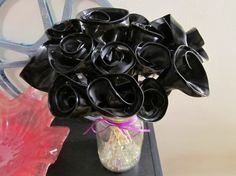 Flowers from vinyl records on etsy $30 for a dozen