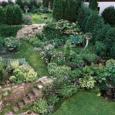 jardin sur une pente verdure sympa fleurs arbres