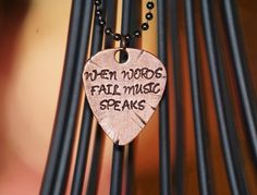 Full size guitar pick necklace by OutRayJessMetal on Etsy