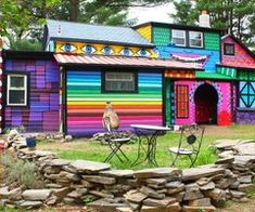.I love this house!! Bright color, blending of color, the watchful eyes...and even the top story face (window eyes and painted mouth)! What fun!!