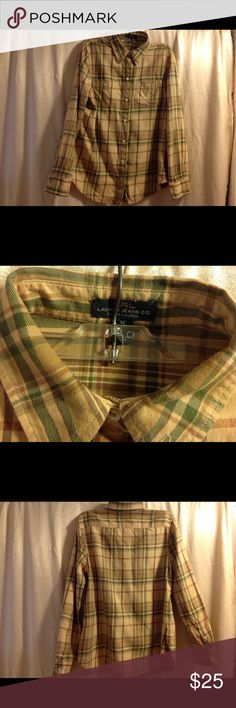 """Ralph Lauren Plaid Flannel Shirt Tan, Green, Brown Ralph Lauren Flannel shirt in Tan, Green, Brown plaid MEDIUM Neck to Hem: 27"""" Shoulder to Shoulder: 15"""" Underarm to Underarm"""""""" 20"""" Sleeve: Long sleeve 23""""  This is a very nice soft Flannel shirt that is 100% Cotton. Ralph Lauren riding sport shirt is not made for the wanna-be cowgirl, this is a very sturdy well made shirt. All of my clothing is washed before li sting (unless it is new with tags) and then bagged in plastic to protect so that…"""