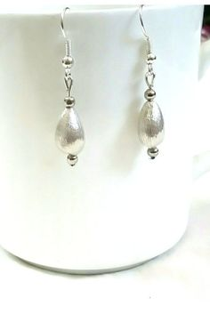Hey, I found this really awesome Etsy listing at https://www.etsy.com/in-en/listing/460263402/brushed-silver-earrings-antique-earrings