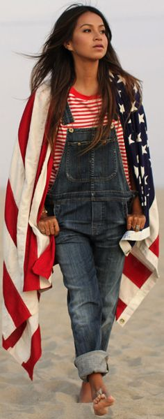 Red and white striped shirt, overalls, gold bracelet, gold rings, flag scarf