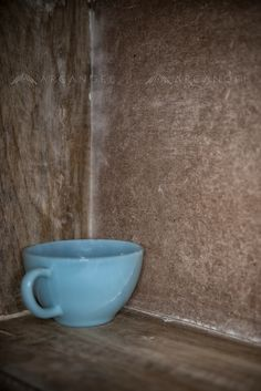 Cracked Blue Teacup Abandoned In the Corner of a Shelf