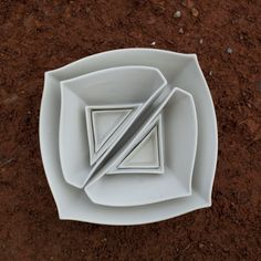 Square+Triangles-shaped nesting bowls based on a square give way to several geometrically-jagged serving triangles~love these