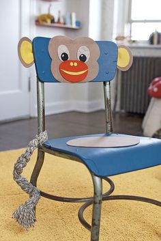 Great idea for re-purposing an old school chair. Just need some spray paint, yarn, felt, and hot glue!