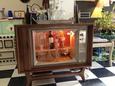 Repurposed upcycled television console into a liquor cabinet