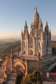 Spain Travel Inspiration - The Sagrat Cor church on top the Tibidabo mountain in Barcelona. Places To Travel, Places To See, Travel Destinations, Beautiful Buildings, Beautiful Places, Places Around The World, Around The Worlds, Sustainable City, Sustainable Architecture