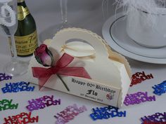Birthday favour, Ivory silk handbag favour box, decorated with burgundy single rose and organza ribbon
