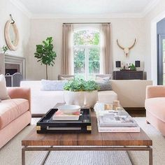 We recommend investing in a pair of blush-pink armchairs like these—versatile and chic, they add just the right amount of playful color to any room.