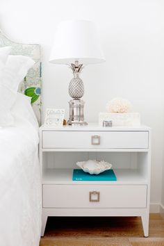 Oliveaux - bedrooms - light hardwood floors, white bed linens, white bed sheets, blue green and gray botanical print headboard.