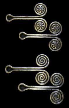 Indonesia ~ North Sumatra | 'Padung Padung' solid cst ear ornaments; silver alloy | Karo Batak people | POR