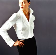 Turned up collar great for long necks. Vertical pleating elongates torso. Dramatic personal style.