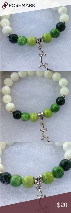 """Mother of Pearl Lizard Bracelet This lovely bracelet is made with natural mother of pearl and green quartzite. The lizard charm is silver tone. This piece is on elastic and will stretch to fit up to an 8"""" wrist.   All PeaceFrog jewelry items are handmade by me! Take a look through my boutique for coordinating jewelry and more unique creations. PeaceFrog Jewelry Bracelets"""