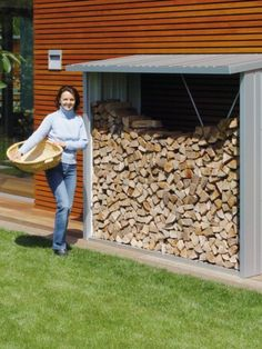 Nothing creates a cosier atmosphere than blazing fire burning in a house on a cold winter day. But how to store firewood? The Biohort-WoodStock provides a tidy and lasting solution. During summer it offers plenty of space for garden equipment. Firewood Stand, Firewood Storage, Shed Storage, Bbq Accessories, Garden Equipment, Single Doors, Woodstock, Outdoor Storage, Garden Furniture