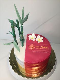 Vietnamese restaurant cake, bamboo, orchids, logo.