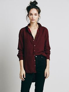 Loose maroon shirt, button down, skinnies and messy bun. Sexy casual look.