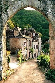 Here is an ancient Town in France with houses built very close together.The narrow lane isn't even paved which is quite charming.