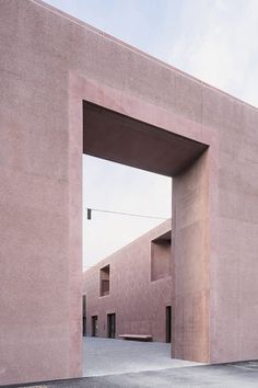 Architecture office Carlana Mezzalira Pentimalli has completed a music school in Bressanone, Italy, comprising monolithic concrete volumes decorated with a subtle hand-hammered pattern.