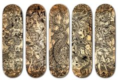 The complete series of custom hand painted skateboards together.
