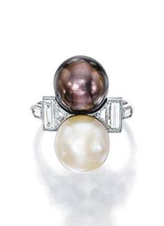 Natural Pearl and Diamond Ring, Chaumet, Circa 1930. Of toi et moi design, set with two button-shaped natural pearls of cream and brown tint, between trapeze and baguette diamond shoulders, with French assay and partial maker's mark for Chaumet. #Chaumet #vinage