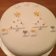 Simple Christmas cake decorated with Christmas trees and presents