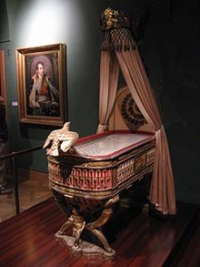 Jean-Baptiste-Claude Odiot - Cradle of the King of Rome, Secular and Ecclesiastical Treasury, Vienna, Austria. Wood, bronze and silver gilt cradle given as a gift by the city of Paris to Napoleon and his wife Empress Marie-Louise, on the birth of their son Napoleon II