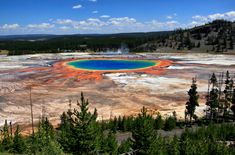 An unaltered photograph of the Grand Prismatic Spring at Yellowstone National Park, in Wyoming, United States. I've been there and it blew my mind.