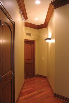 Interior Doors | Arch Top Panel Door With A Dark Stain To Match The Crown  Moulding