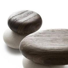 The ingenious overlaying of two natural surfaces creates the distinctive Pavé Seating system. Italian designer Enzo Berti conceived this functional yet highly sculptural system for Kreoo by Decormarmi. Evocative of smooth, round beach pebbles, a marble base is paired with a natural wood seat formed from Larch and hand-sanded to a stunning, satiny finish. Avant-garde, exquisitely hip and stylish, the seat can be centered or offset from the stone to create different combinations.