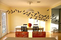 """Halloween decoration flying bats on the wall, we made ours with felt so they can be re-used next year but if you do this you will need to use """"gaff tape"""" to get them to stay on the wall."""