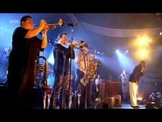 Tower Of Power - Knock Yourself Out Still the best horn section ever. Try not to tap your toe :)
