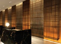 Hilton London Bankside   interior design   hotel design   reception   bespoke mesh wall   polished concrete   black marble   metal details   yellow gold