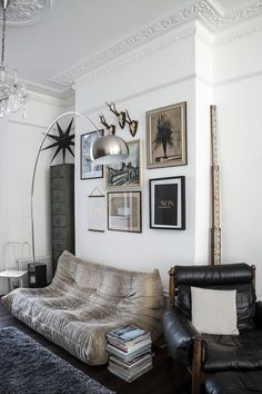 From Mademoiselle Poirot, further proof that modern pieces look great in traditional spaces, and that adding one or two antiques to a modern mix instantly makes things more interesting.