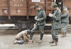 Wounded German soldiers getting their boots cleaned by a Russian peasant child while at a train station on the Eastern Front March . Note how young these soldiers were. As the war gets older, the soldiers become younger. German Soldiers Ww2, German Army, Germany Ww2, Vietnam War Photos, War Photography, Military Photos, American Civil War, World War Two, Germany