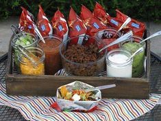 Here's a great idea for dinner for near the campfire! A walking taco bar! Have a small bag of chips for each person and let them each choose the items they want in their walking taco