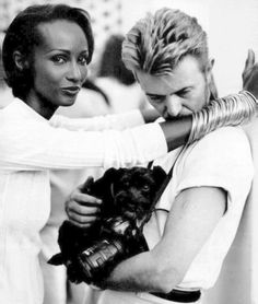 Gotta love a man who loves his woman & his dog....passionate couple! Iman Abdulmajid-Bowie & her lover.