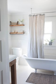 Farmhouse Bathroom Makeover Clawfoot Tub and Floating Shelves