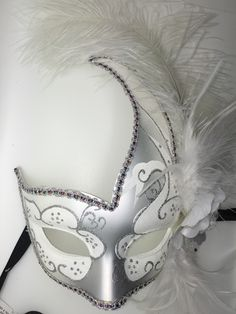 White and Silver feathered Mardi Gras mask with ribbon ties.