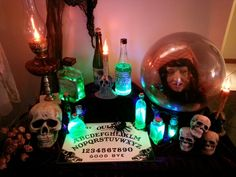 Halloween fortune teller table with glowing potion bottles. Halloween diy.  Design by Marc P.