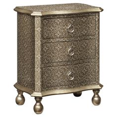 Nice French Flare. 3-drawer chest in gold and silver with scrolling details and ball feet.  Product: Chest Construction Material: En...