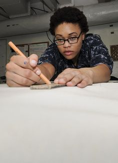GULF OF OMAN (June 19, 2013) Seaman Kyoko Washington, of Lancaster, Calif., measures material to cut for the refurbishment of a foot bench in the Sail Loft on board aircraft carrier USS Nimitz (CVN 68). Nimitz Strike Group is deployed to the U.S. 5th Fleet area of responsibility conducting maritime security operations, theater security cooperation efforts and support missions for Operation Enduring Freedom.