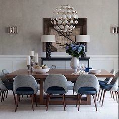 Via Knoll, inc. Mid century two toned chair, modern lighting, grey and teal color palette.