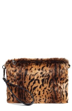 Fierce leopard spots dapple a sleek wristlet clutch crafted in plush, lavish faux fur. Style Name: Chelsea28 Leopard Print Faux Fur Wristlet Clutch. Style Number: 5425279. Available in stores.