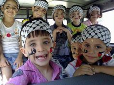 Palestinian children with the Palestine name and flag written/painted on their faces