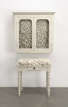 'Armoire blanche et table blanche','White cabinet and white table', 1965 – by Marcel Broodhaers, Belgian 1924-1976, poet, filmmaker and artist | The Museum of Modern Art, New York. Fractional and promised gift of Jo Carole and Ronald S. Lauder, 1992. © 2015 Estate of Marcel Broodthaers / Artists Rights Society (ARS), New York / SABAM, Brussels.